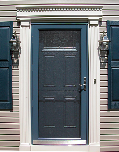 decorative storm door. Add beauty  energy efficiency and security to your home with quality doors from AMEREX Whether you need solid entry storm or decorative patio Doors American Exteriors